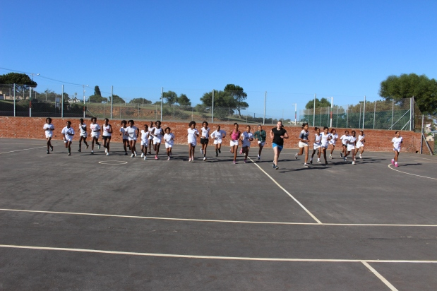 Netball coaches Jo and Jess leading some warm ups on tournament day.